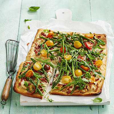 plate pizza with salad of green asparagus