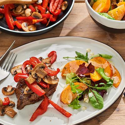 fried steak with mushrooms and kaki salad