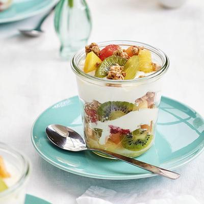 jar of greek yogurt with cruesli