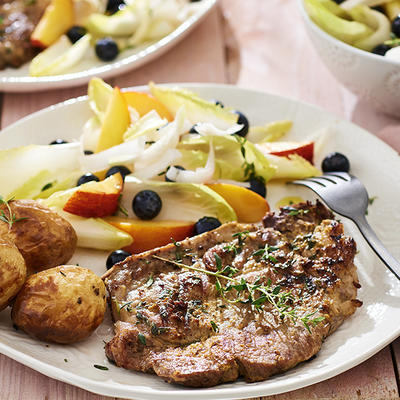 shoulder chop with mustard and chicory salad