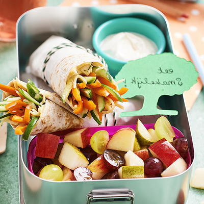 kids lunch box with vegetable wraps and fruit