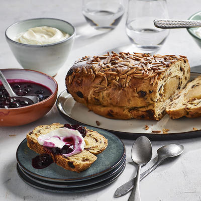 nut roll with mascarpone and warm blueberries