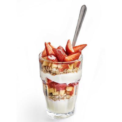 yogurt with muesli, grated apple and strawberries