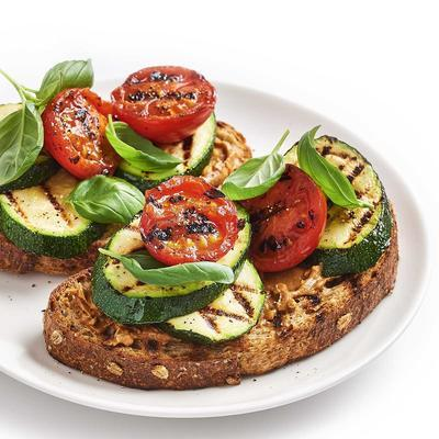 bruschette with roasted zucchini and tomato