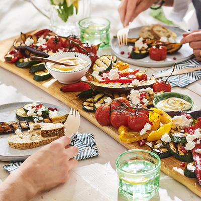 plank with grilled vegetables, feta and pomegranate seeds