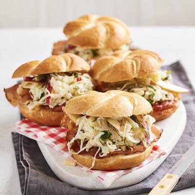 roll of warm ham with sauerkraut salad