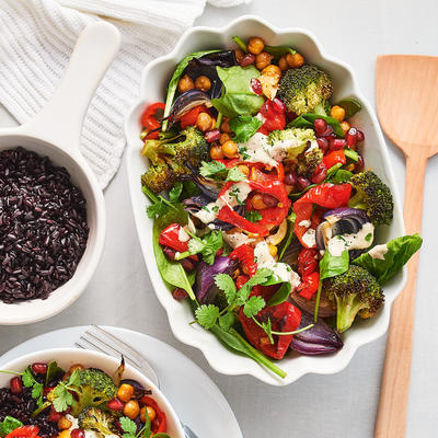 warm chickpea salad with vegetables from the oven