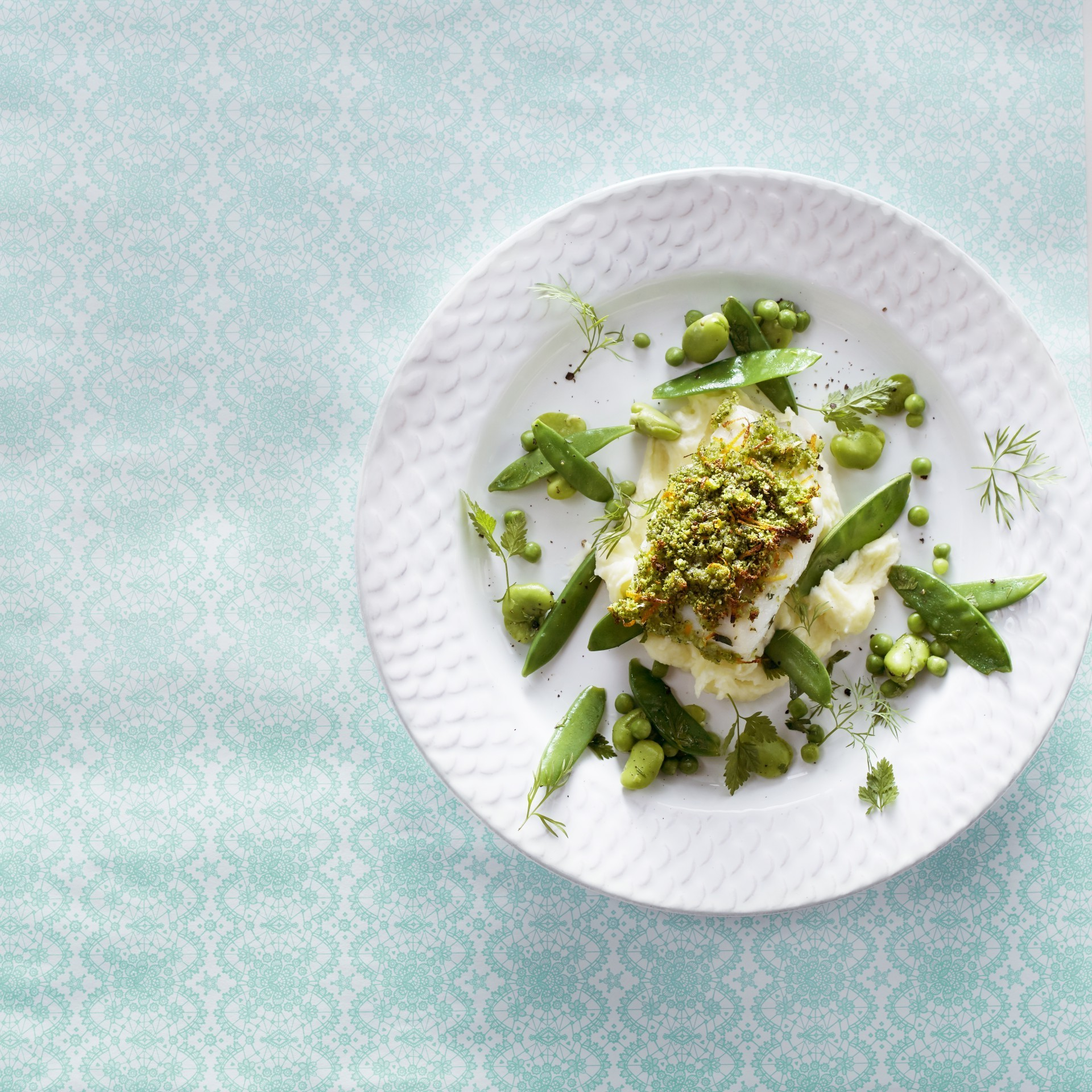 Cod fillet with citrus herb crust and legumes