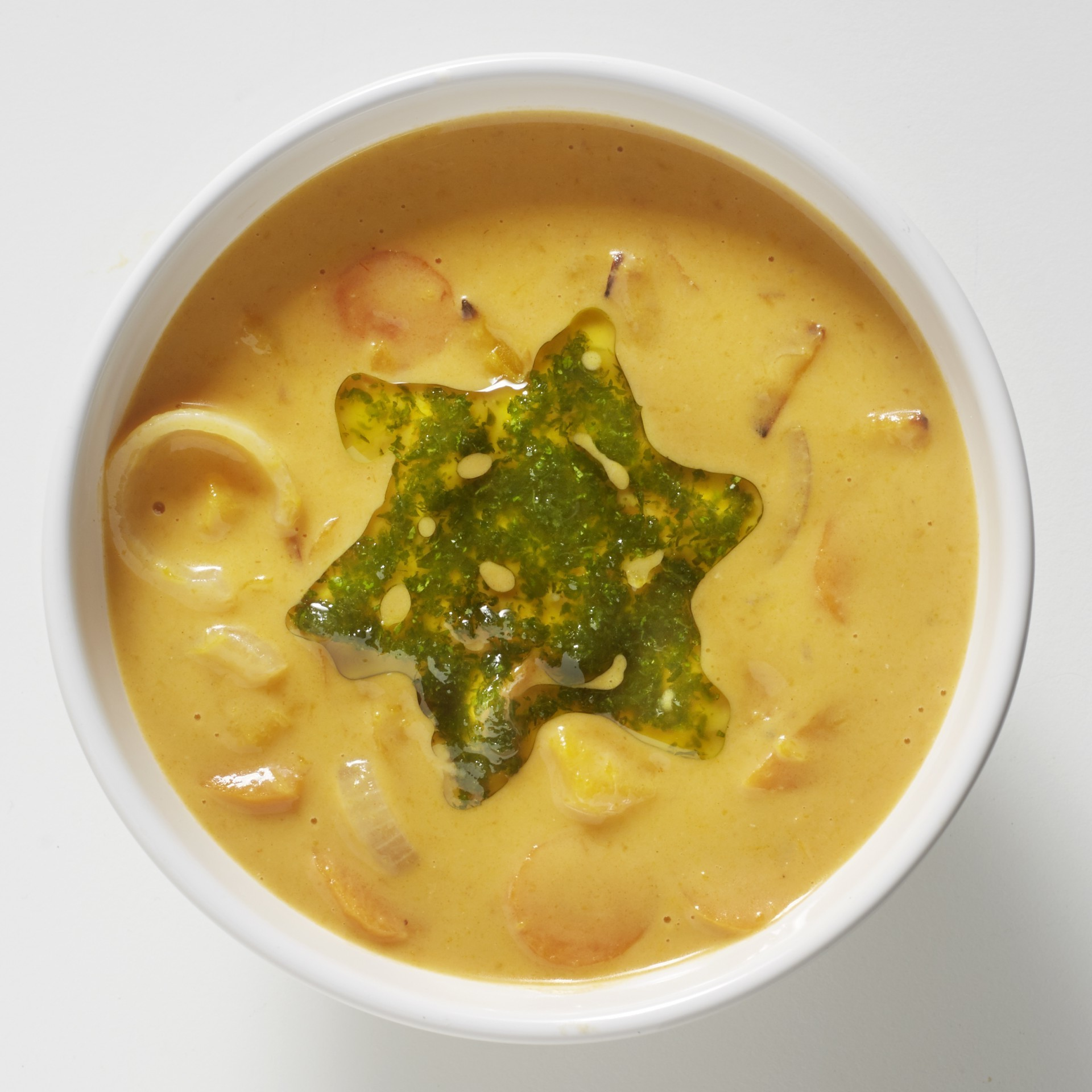 Carrot pumpkin soup with coriander oil