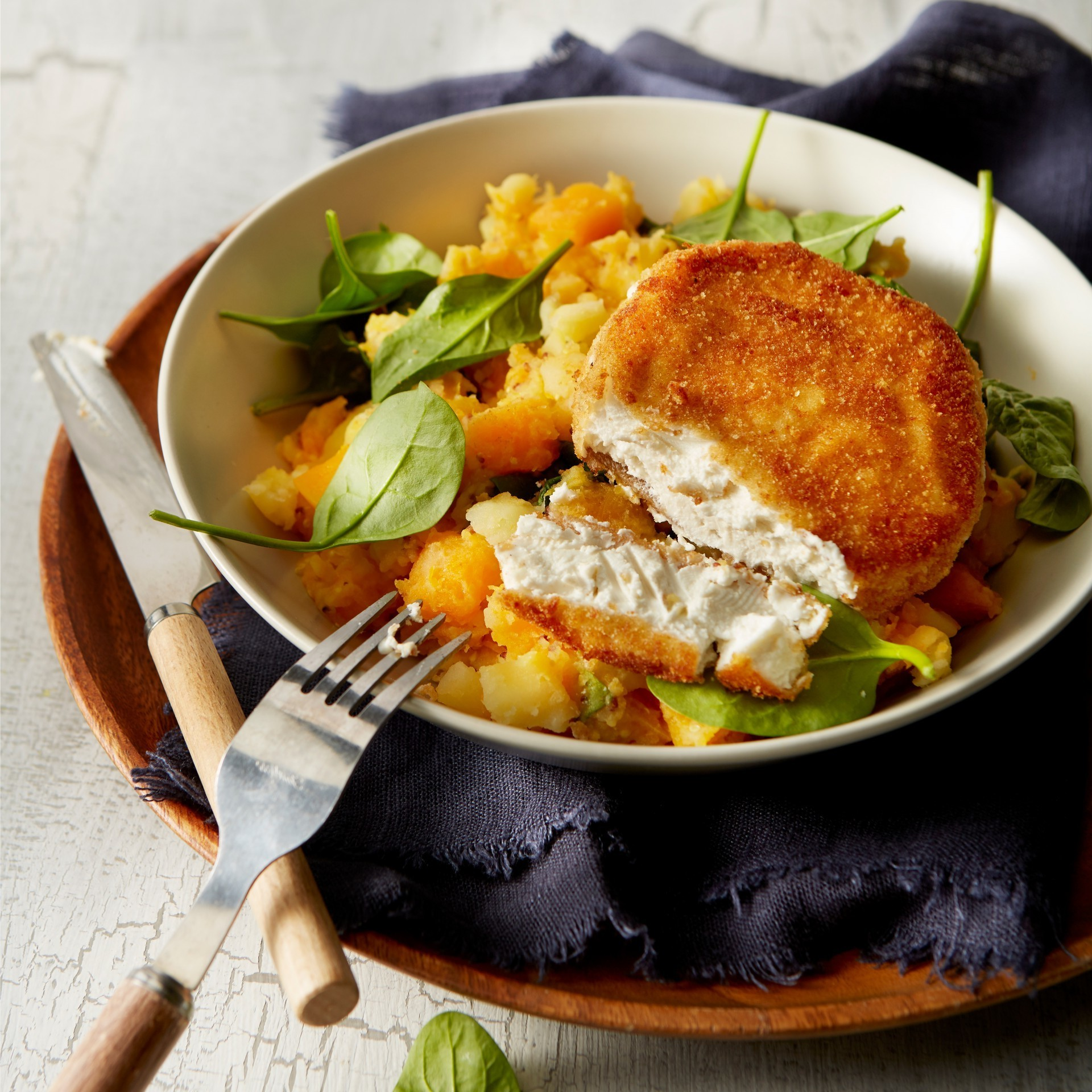 Pumpkin stew with spinach and crispy goat's cheese