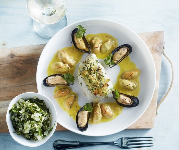 Scalloped cod with saffron sauce and mussels