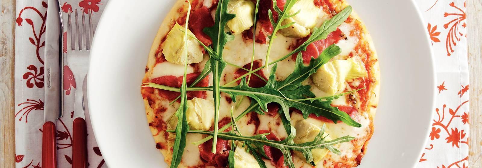 Pizza with ham and artichoke
