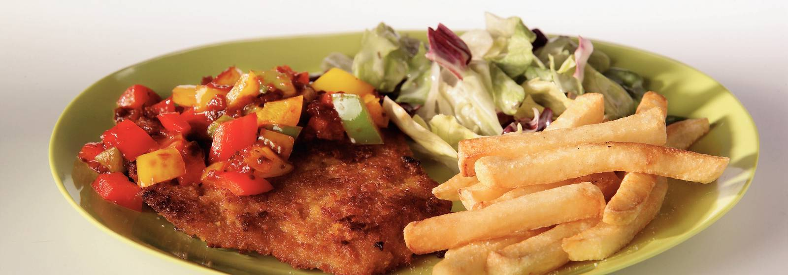 Schnitzel with paprika sauce and French fries
