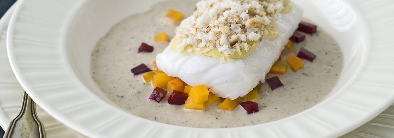 Cod with pumpkin and beetroot in veal cream sauce