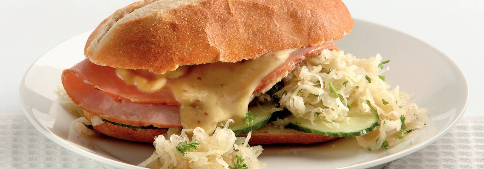 Roll of ham with hot sauerkraut