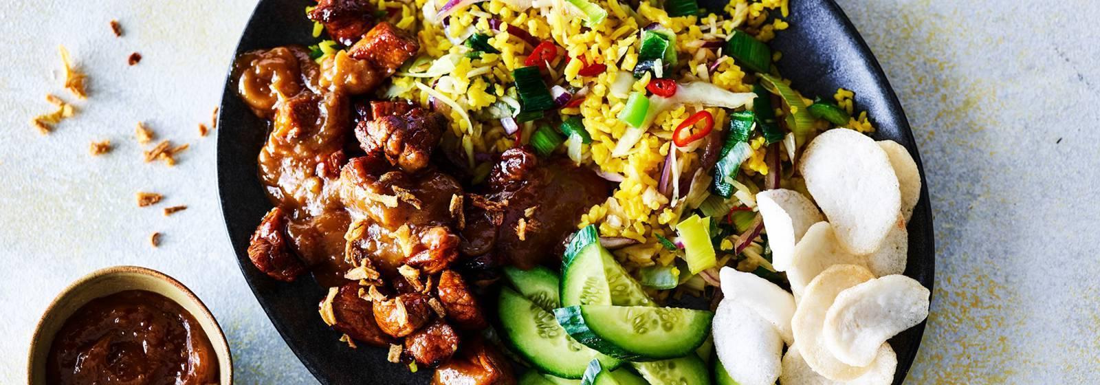 Thai rice stir-fry with vegetables, marinated pork and satay sauce